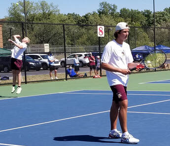 Chesterton Freshman Brock Redman (left) and Senior John Powell ready themselves for their #1 Doubles match Saturday, September 5, at the Crown Point Invitational.