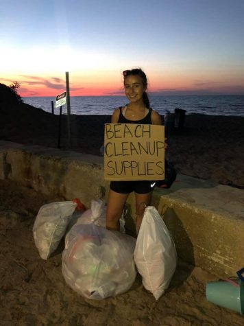 Bella Aurcchio hands out free cleanup supplies